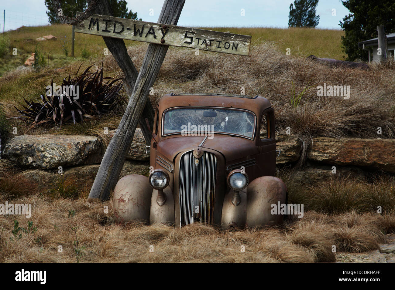 Old car at midway point between Alexandra and Chatto Creek, Otago Central Rail Trail, Central Otago, South Island, New Zealand - Stock Image