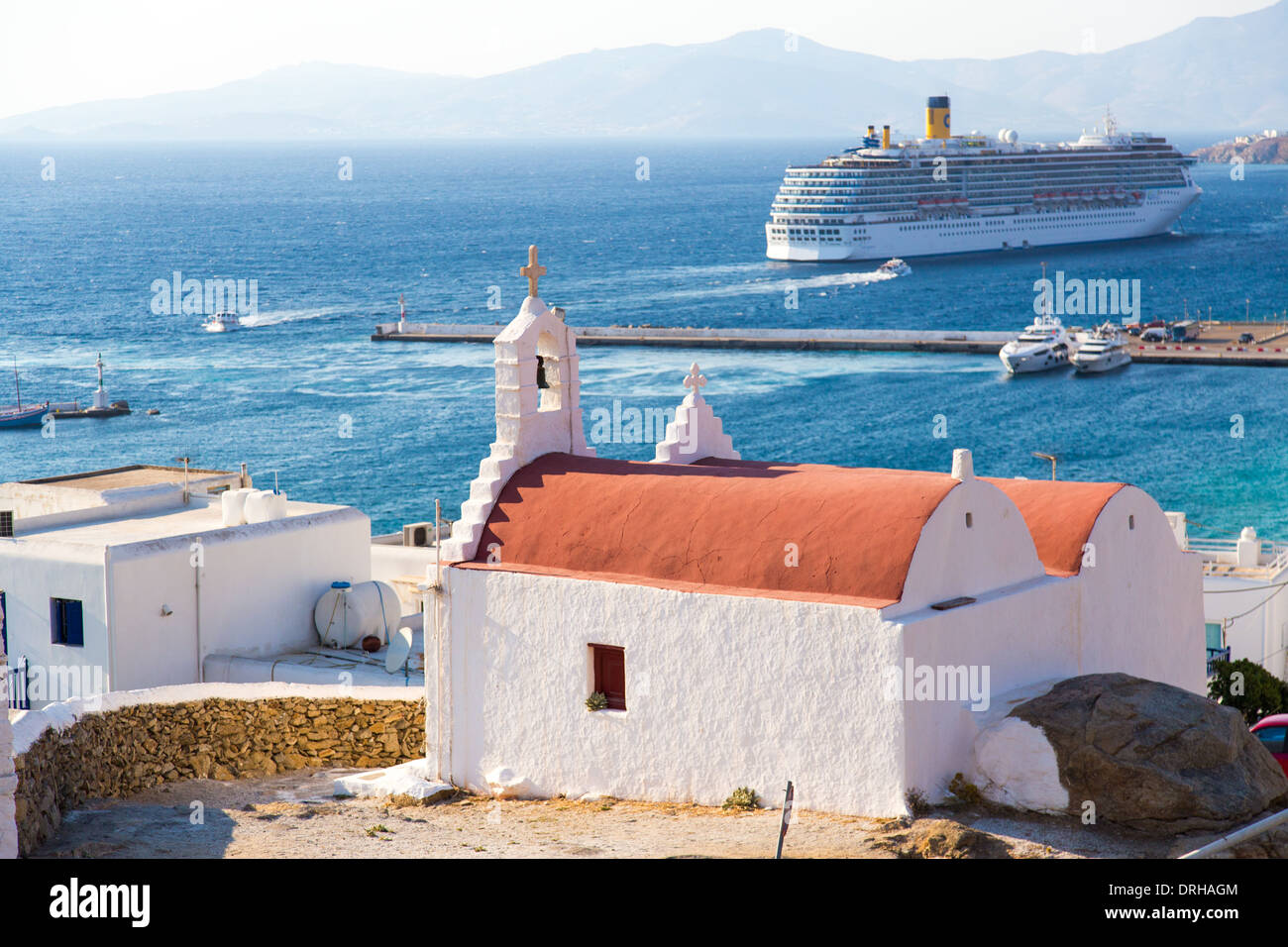 Church and cruise ship in Mykonos Cyclades Greece - Stock Image