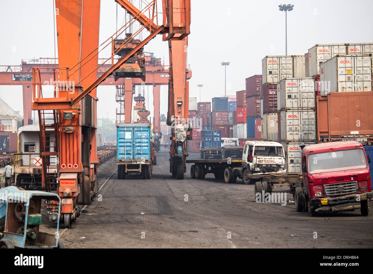 Freight containers at a train shipping facility in Delhi, India - Stock Image