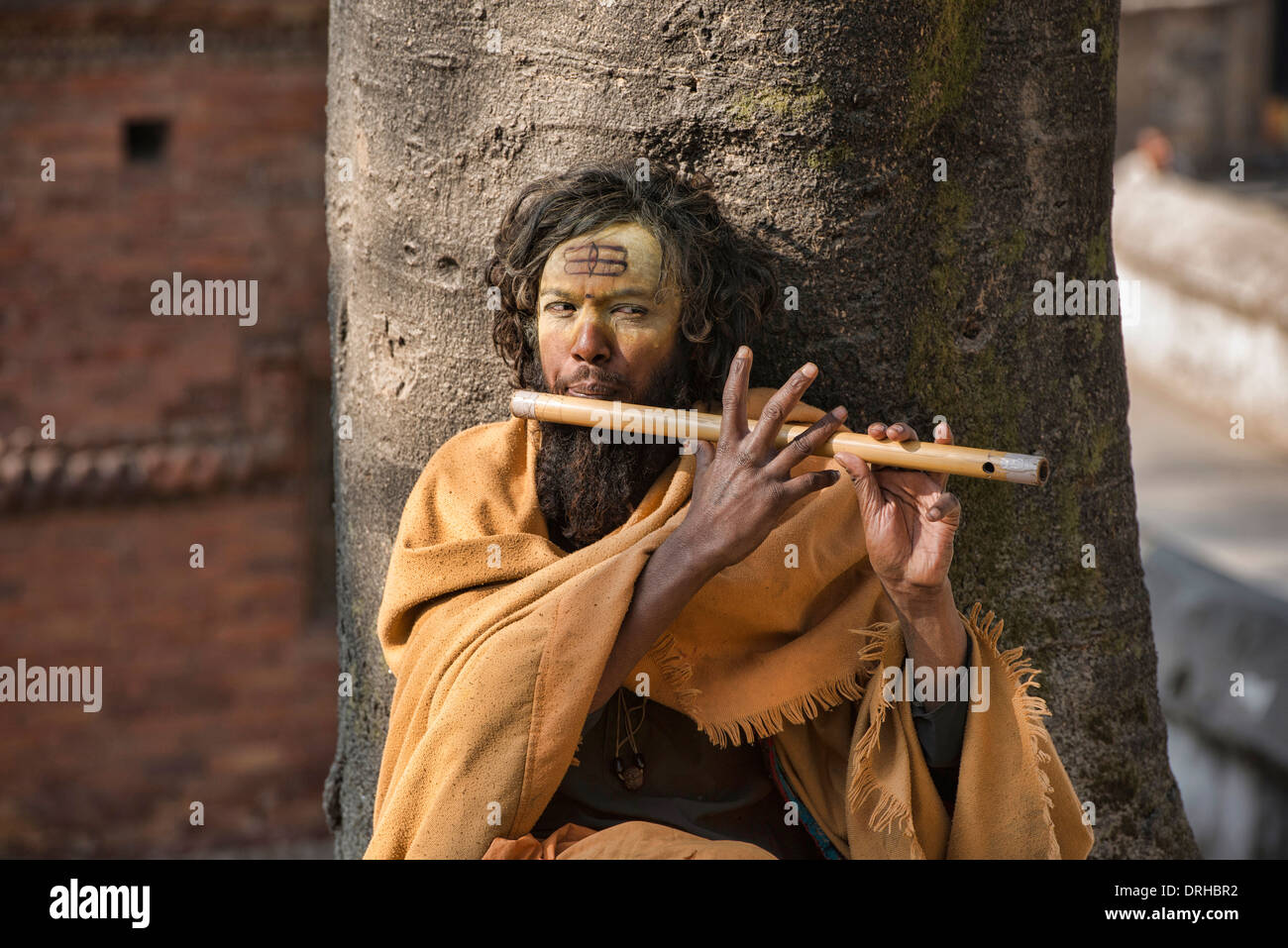 Sadhu playing his flute, Kathmandu, Nepal - Stock Image