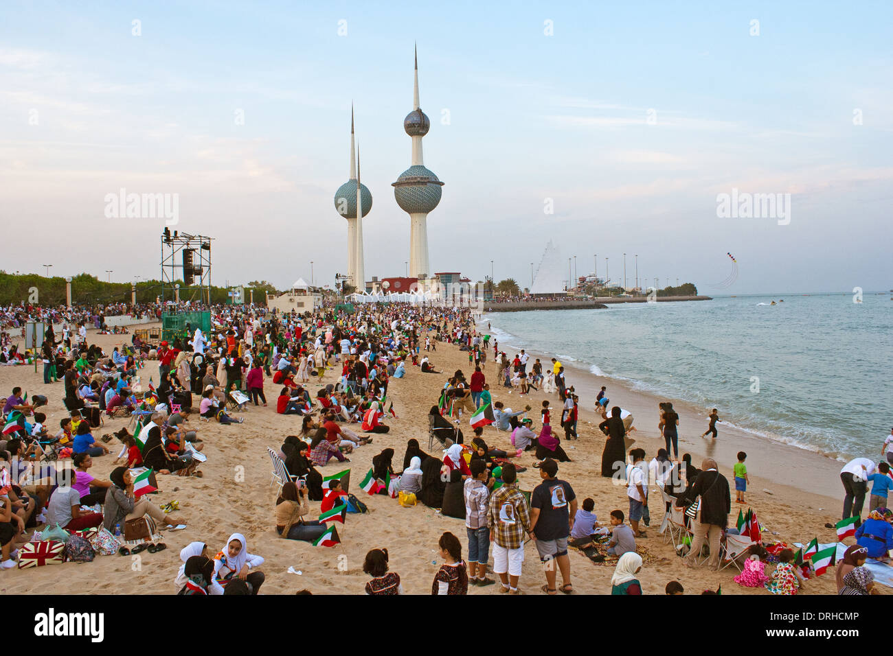 kuwaiti people celebrates constitution anniversary near Kuwait towers shore - Stock Image