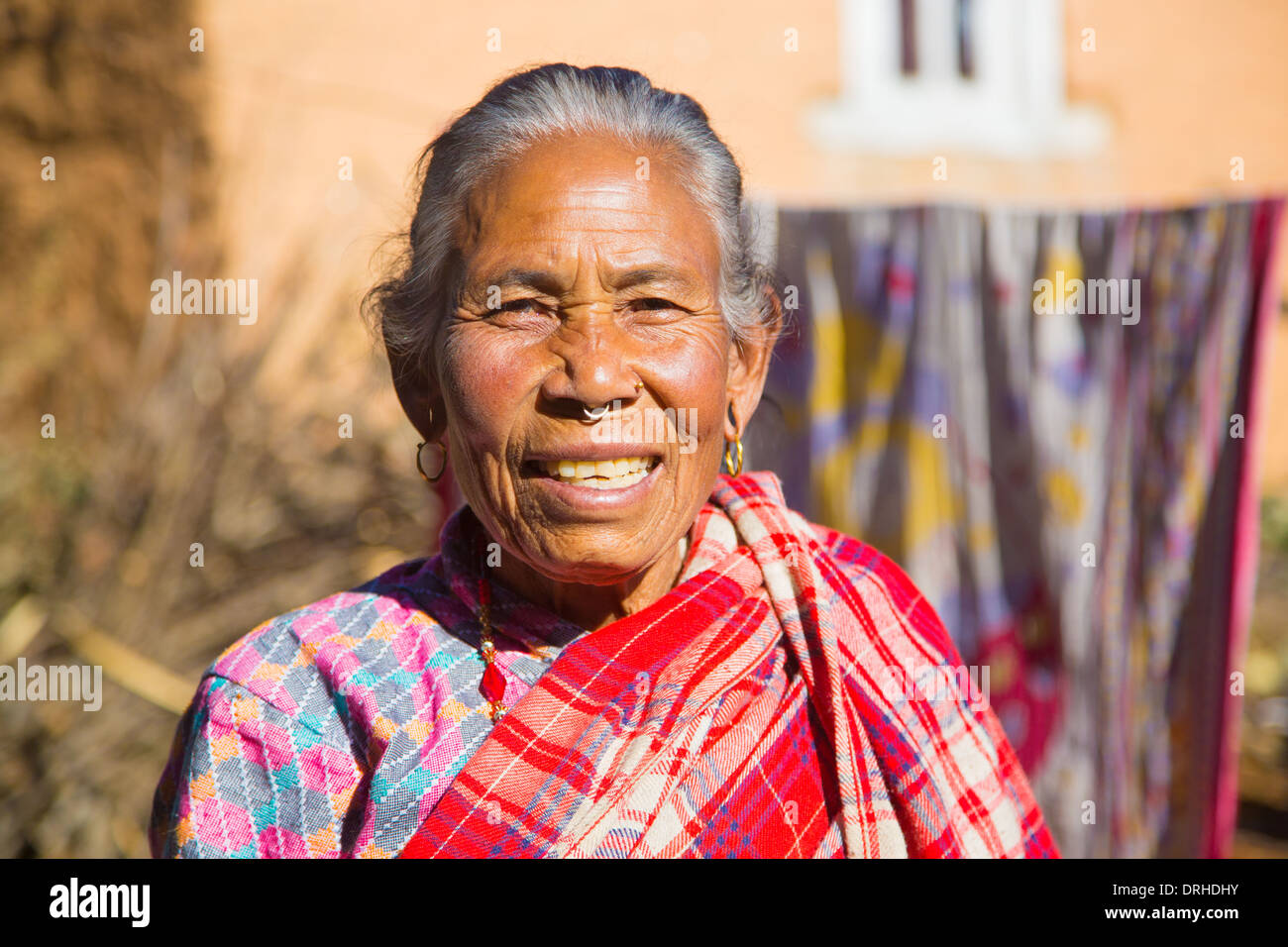 Elderly Nepalese woman in the hills above Kathmandu, Nepal - Stock Image