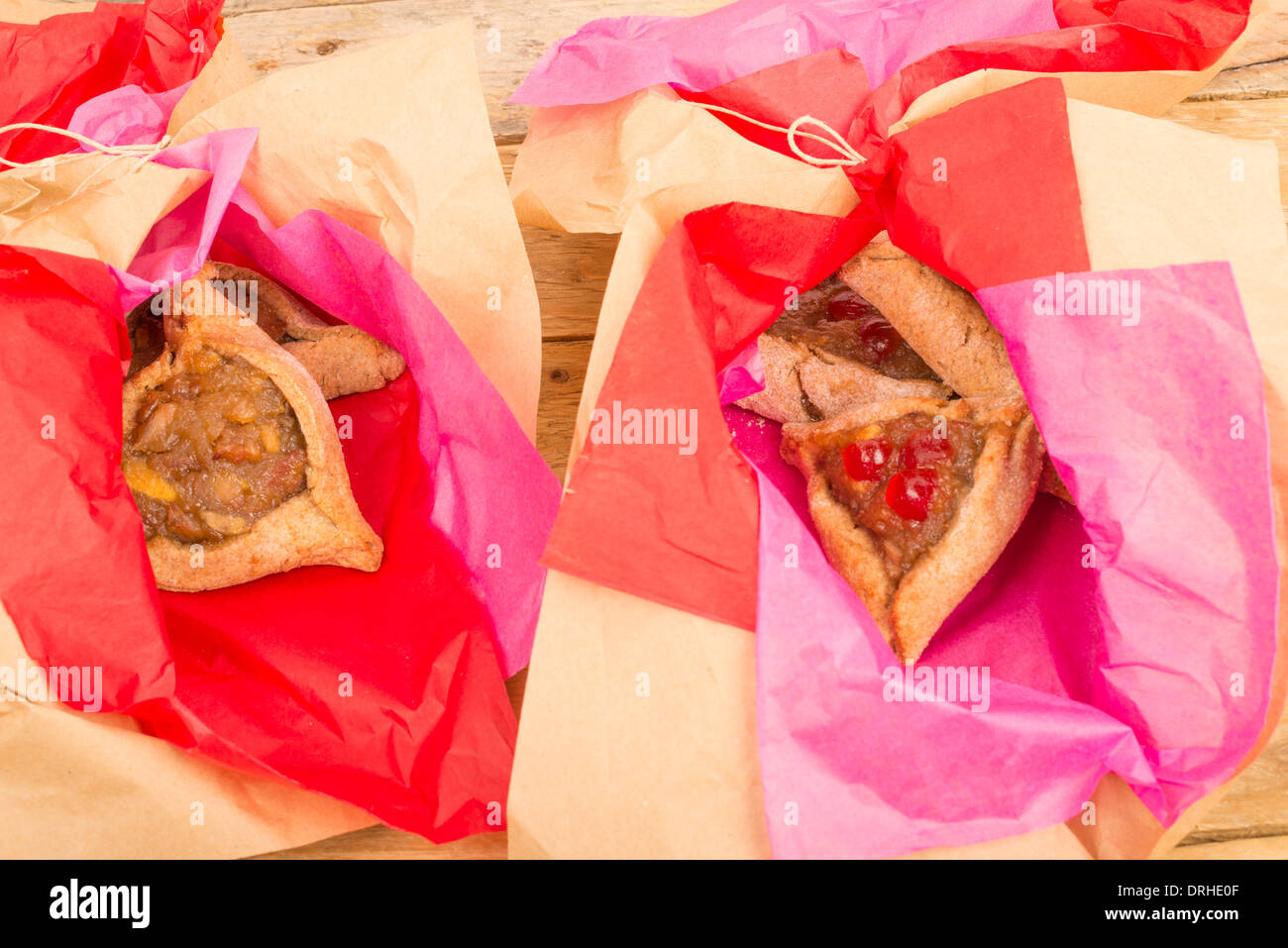 Traditional homemade hamestaschen in a festive wrapping - Stock Image