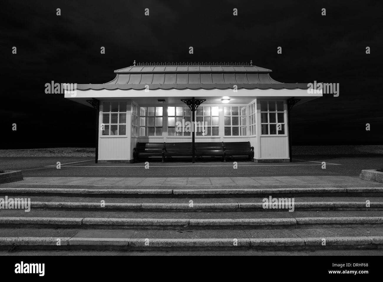 Black and White image, Shelter at Splash Point, Worthing town, West Sussex County, England, UK - Stock Image