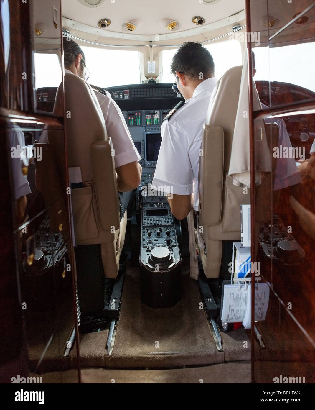 Pilot And Copilot Operating Private Jet - Stock Image
