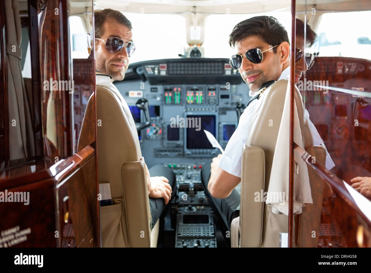 Confident Pilots In Cockpit Of Plane - Stock Image