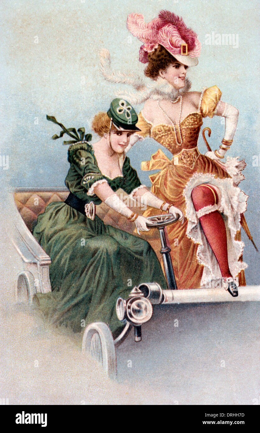 Moulin Rouge showgirls posing in an old fashioned car. - Stock Image