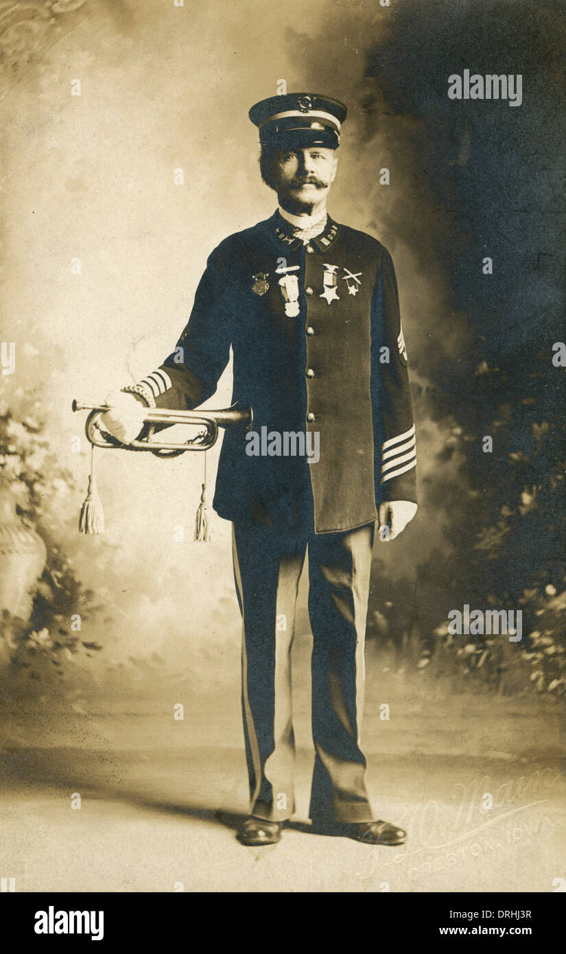 Portrait photograph of an American army officer with a bugle - Stock Image