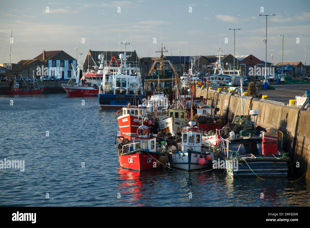 Fishing trawlers moored in Howth harbour, County Dublin, Ireland. - Stock Image
