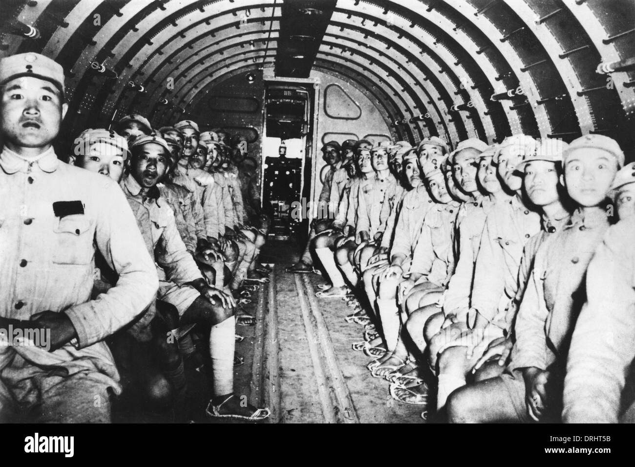 Chinese troops on U.S. army plane - Stock Image