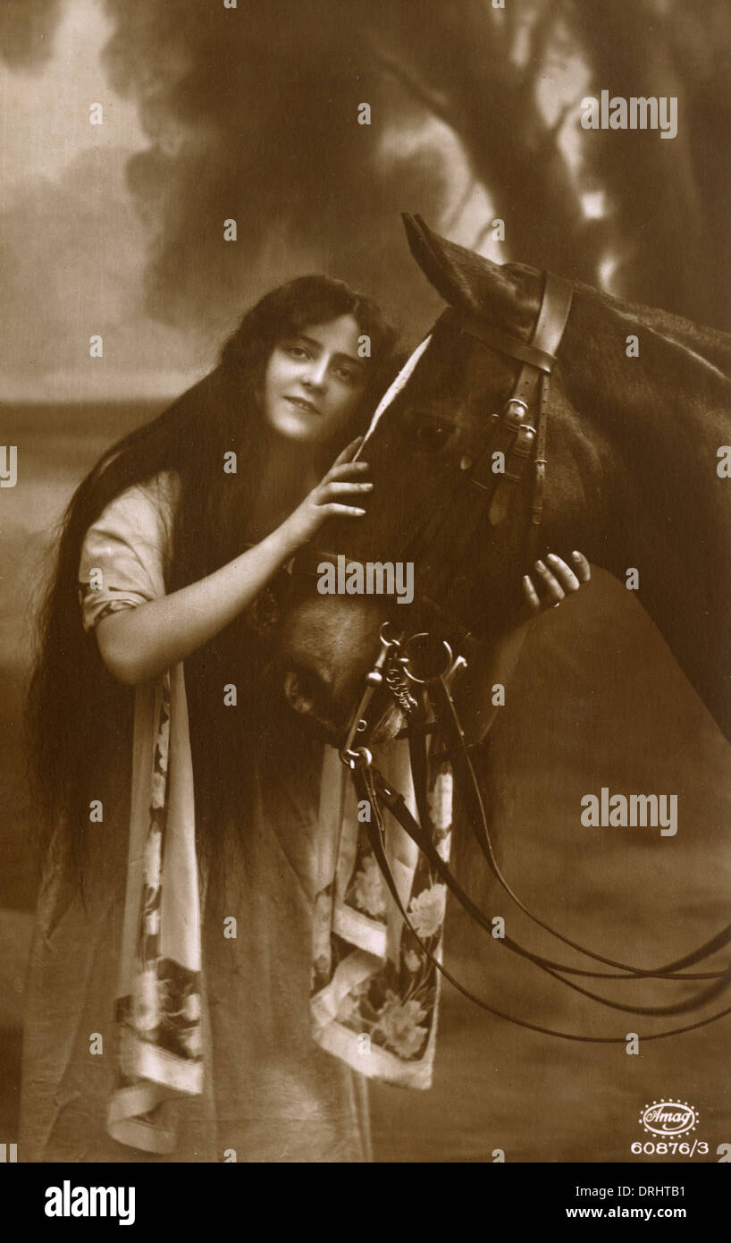 A Young Woman and her favourite horse - Stock Image