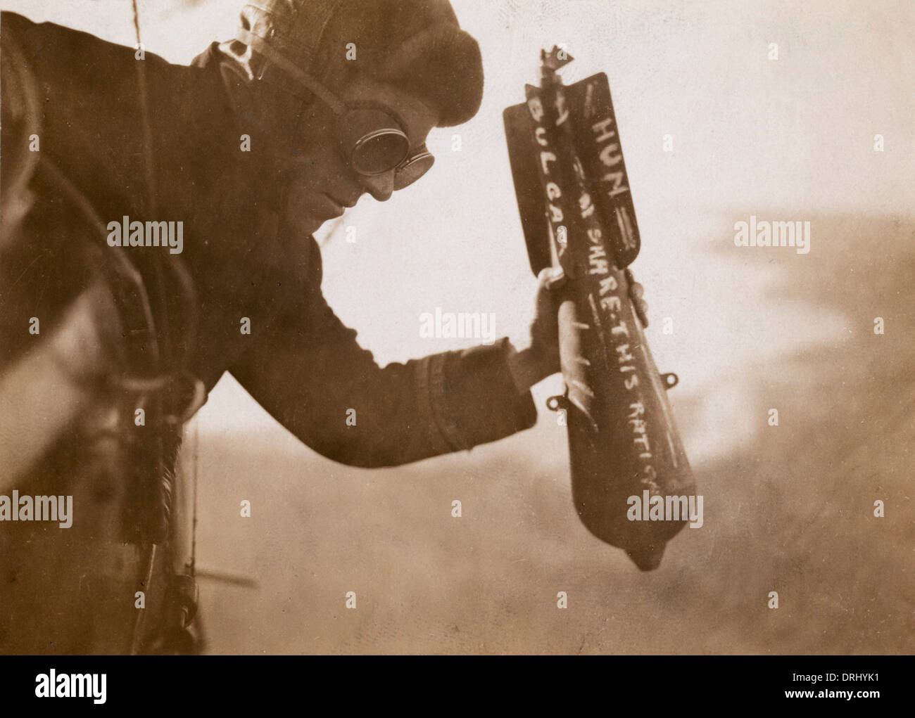 British airman dropping a bomb by hand, WW1 - Stock Image