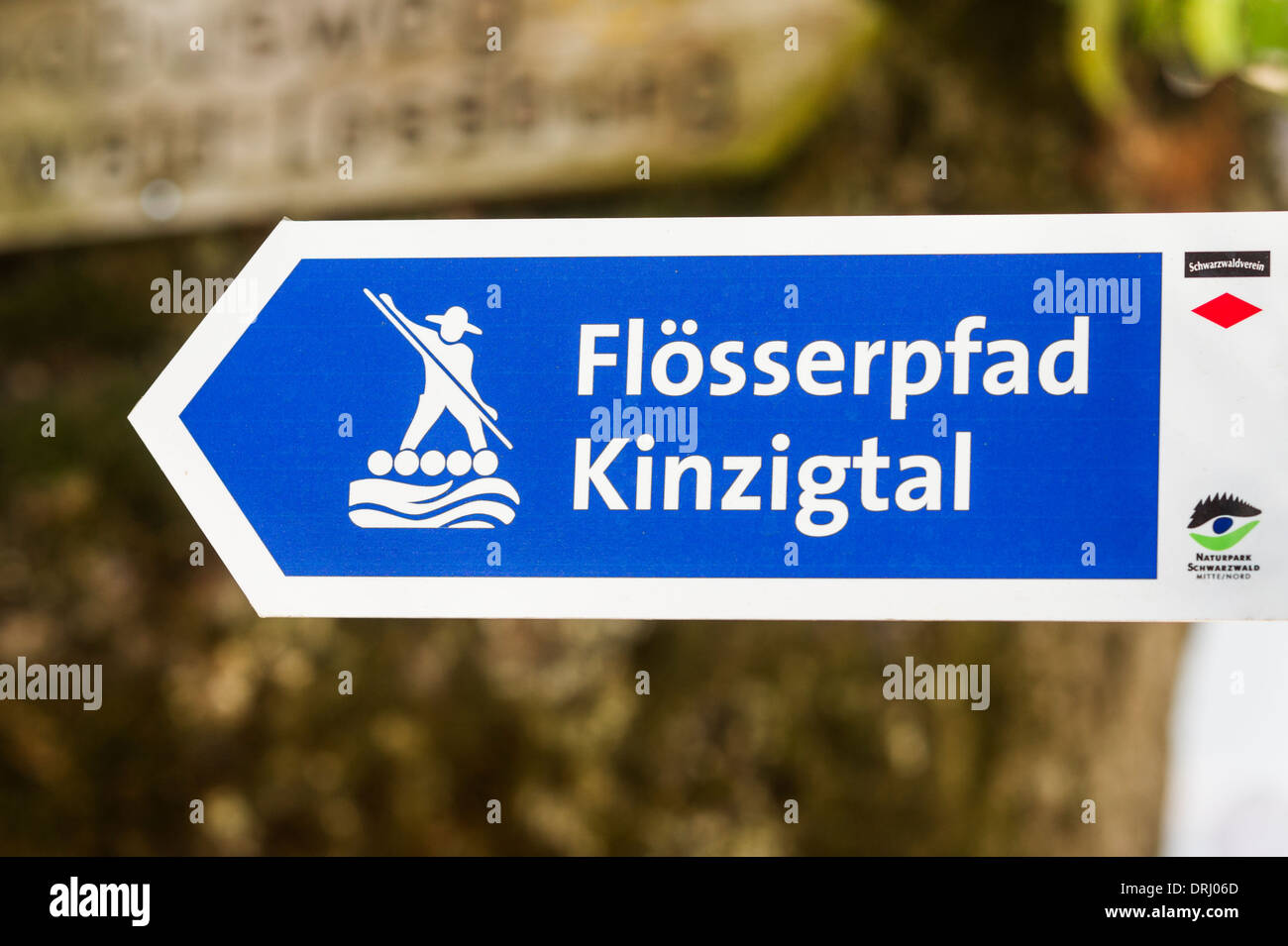 signpost showing a pictogram of a wood rafter an the inscription: floesserpfad kinzigtal, wood rafter´s trail valley of river ki - Stock Image