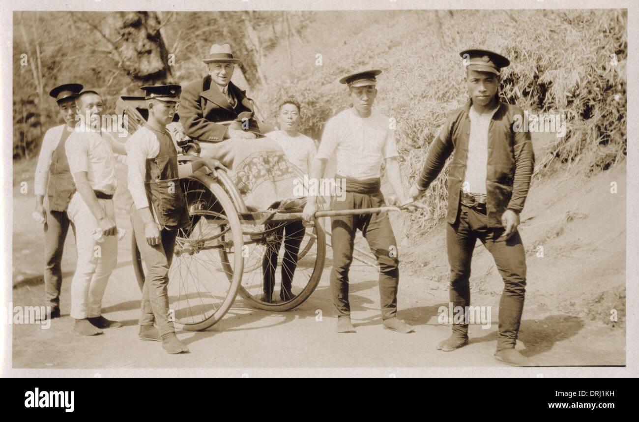Englishman in rickshaw with Japanese attendants - Stock Image