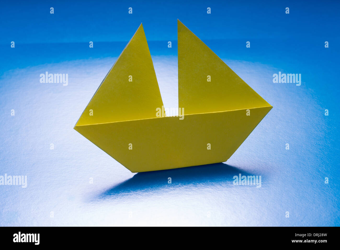 Paper Yellow Boat Sailing On Blue Sea Origami Ship