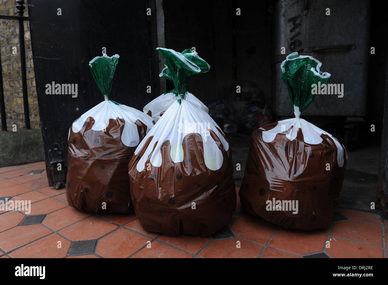 Rubbish bags with a christmas pudding design - Stock Image