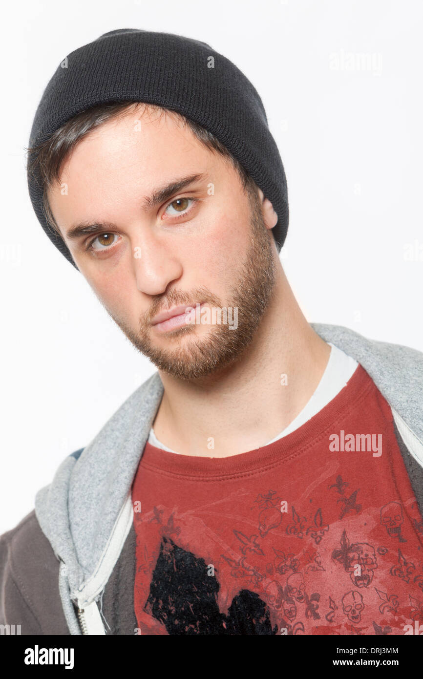 A Young Man Dressed With A Hoodie Poses As A Gangster With A Black Stock Photo Alamy
