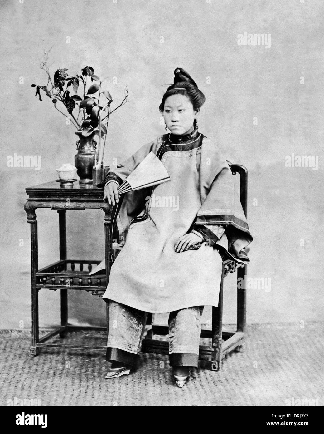Woman with bound feet, China - Stock Image