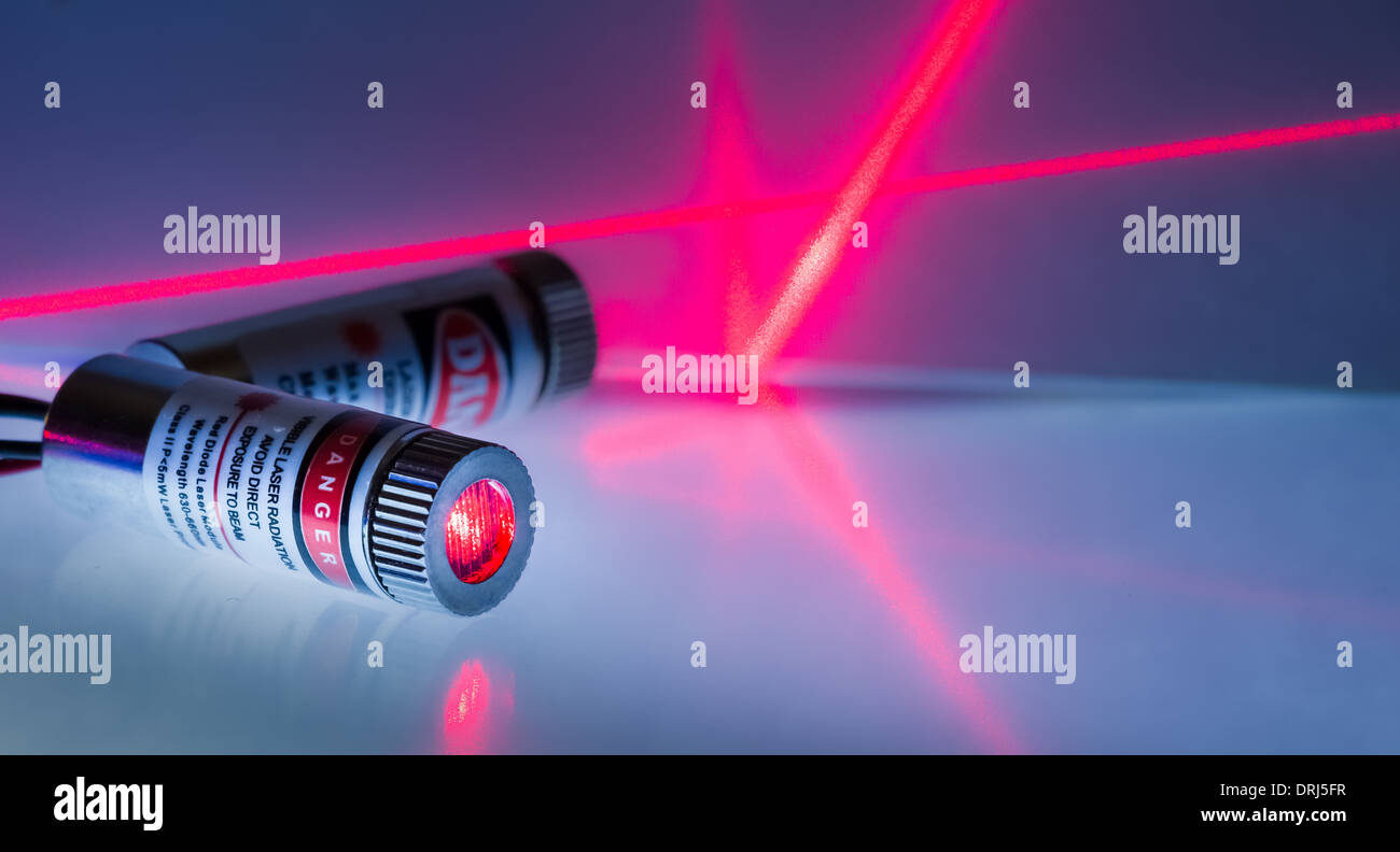 Two red laser modules turned on - Stock Image