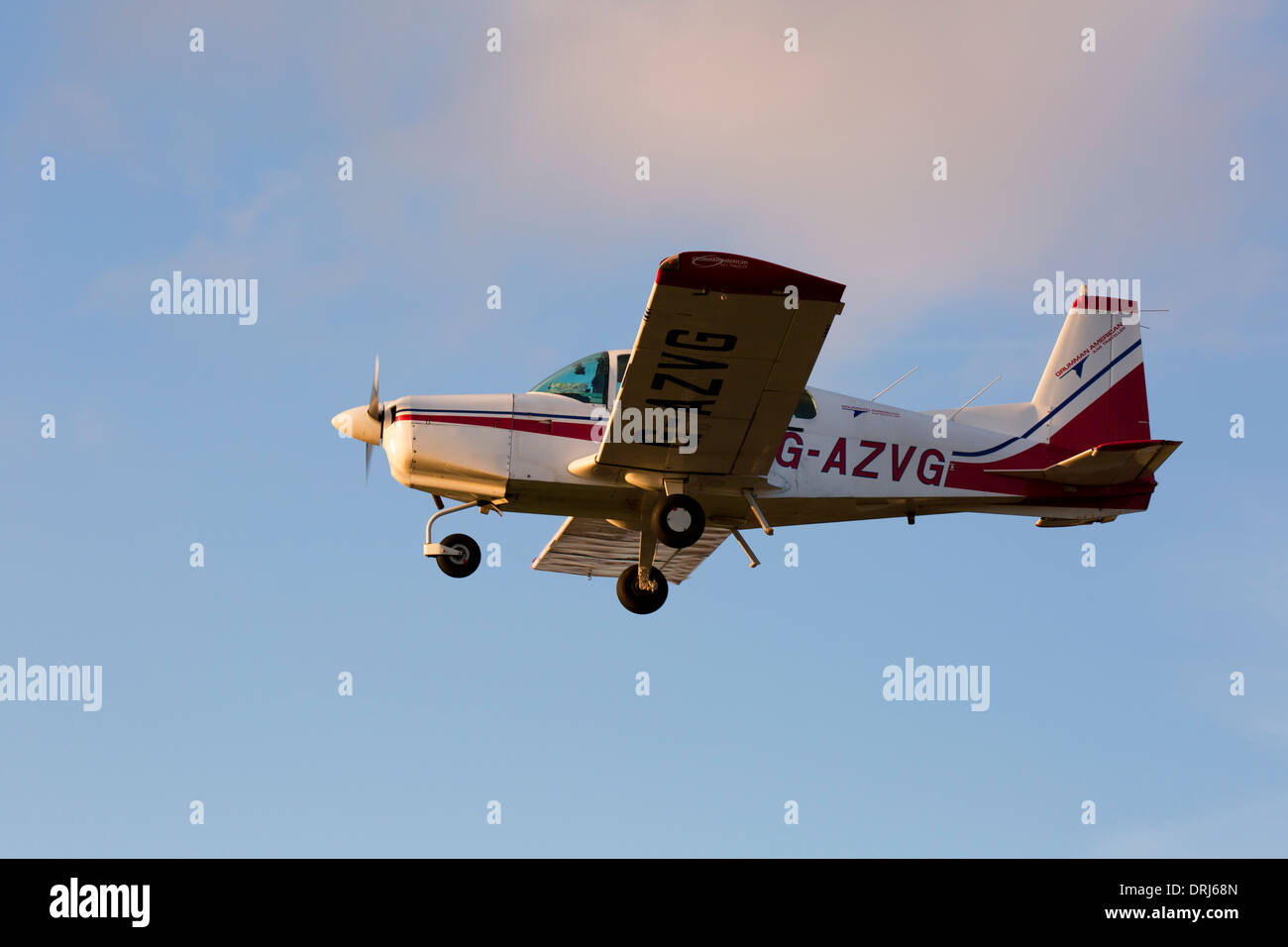 Grumman American AA5 Traveller G-AZVG in flight at Sandtoft Airfield - Stock Image
