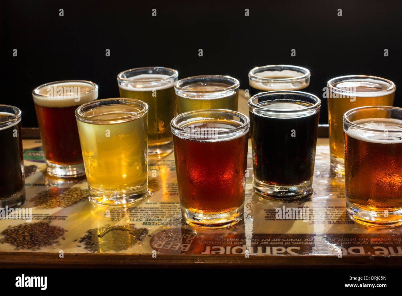 flight of beers for tasting in a brew pub - Stock Image