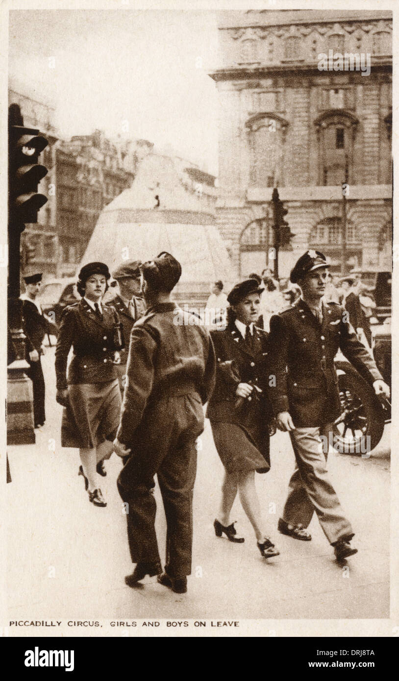 Male and Female British Servicemen - Piccadilly Circus - Stock Image
