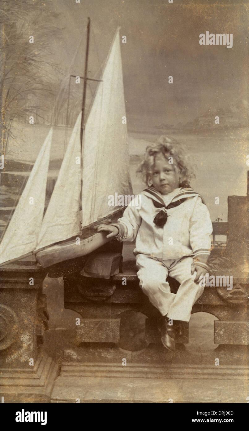 Lillle Boy Toys Boats : Boy sailor suit stock photos