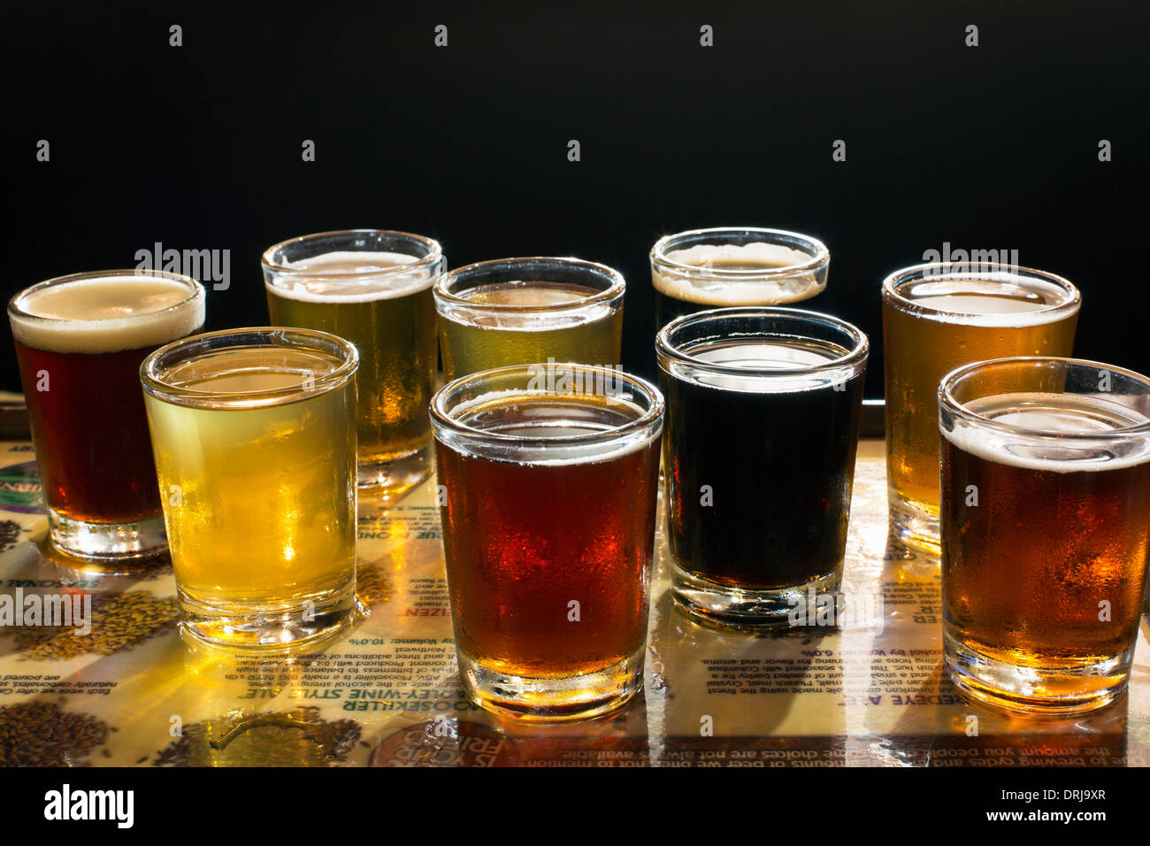 flight of beers served in a brew pub - Stock Image