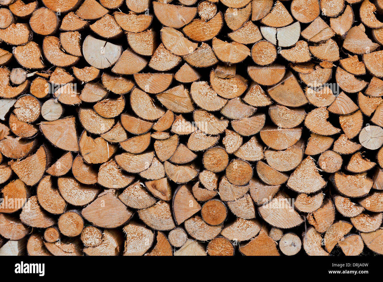 Stack of split firewood used as wood fuel - Stock Image
