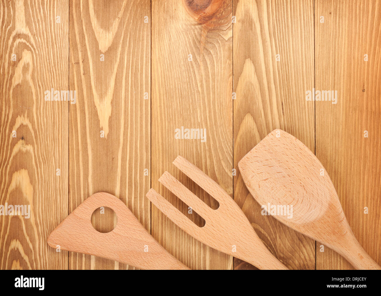 Kitchen utensils on wooden table background View from above with