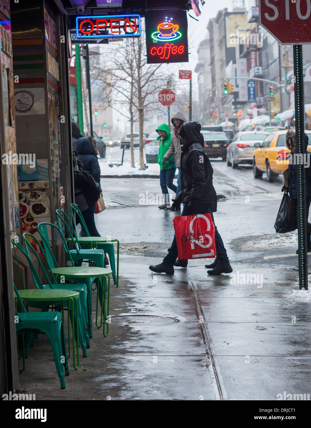 Passer-by in Chinatown in New York contend with even more snow Stock Photo