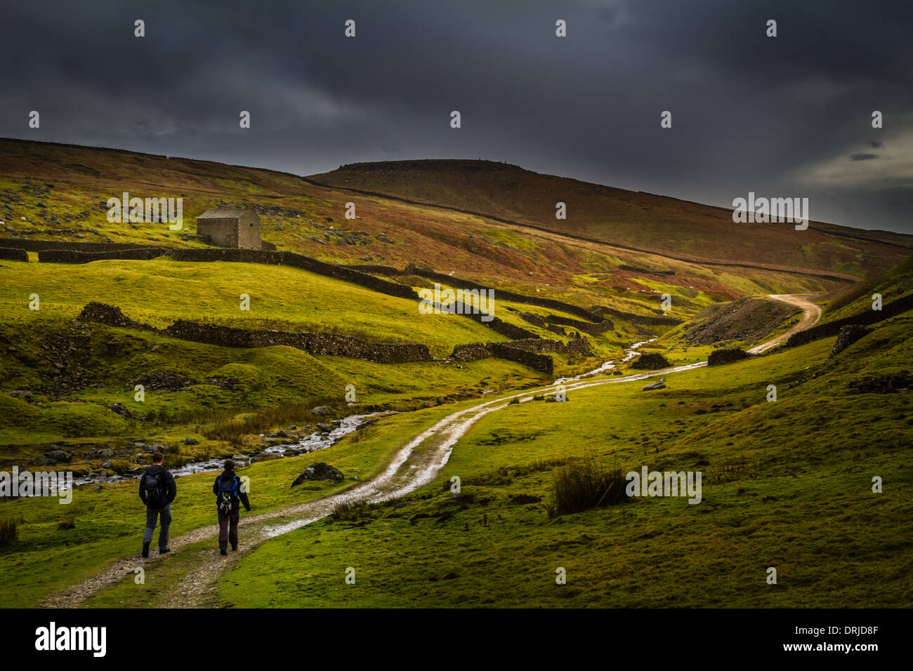 Grassington lead mines circular walk with two people on a winter ramble, Yorkshire, UK - Stock Image
