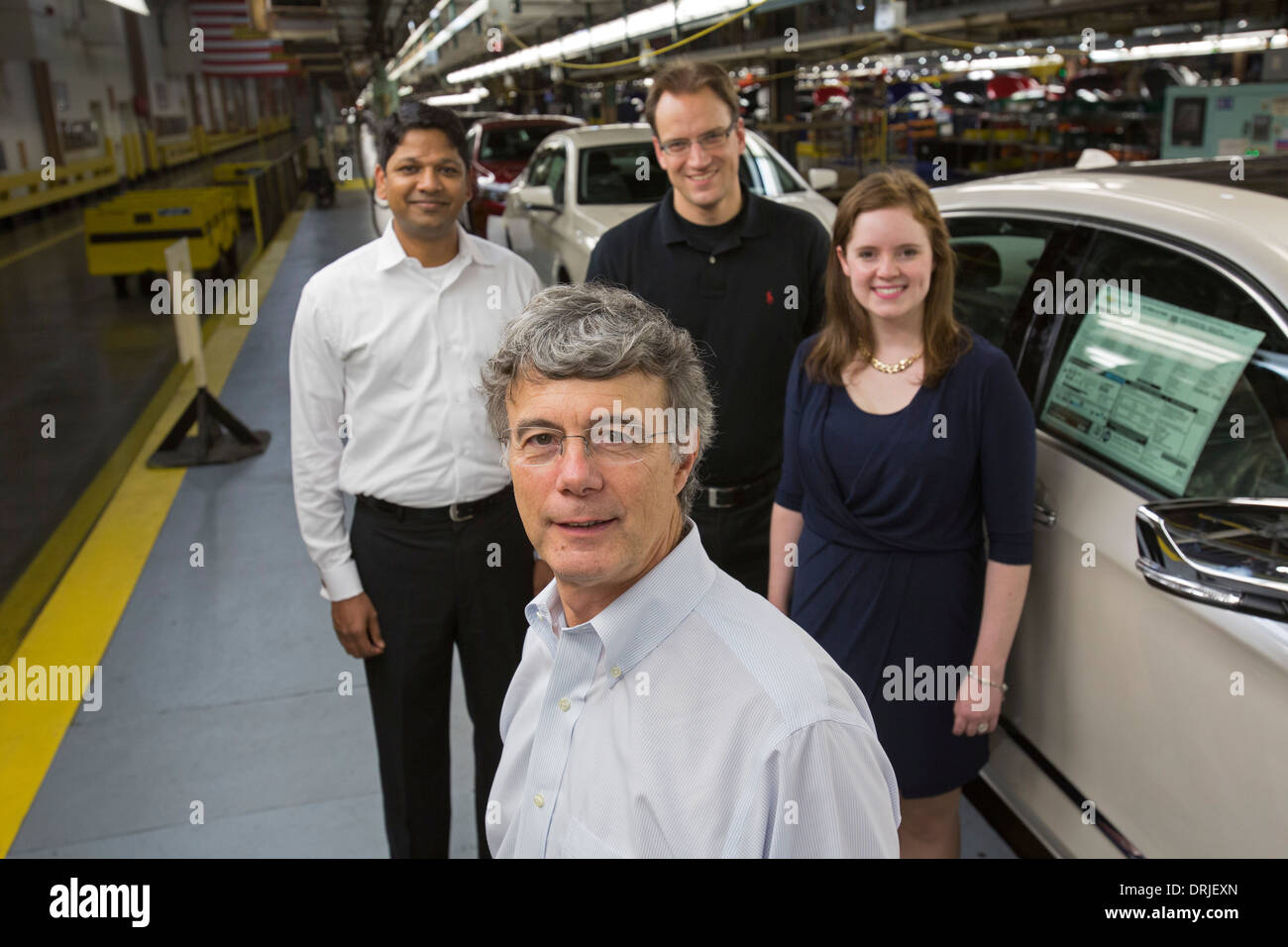 Xavier Mosquet (front) with his Boston Consulting Group team at General Motors' Detroit-Hamtramck Assembly Plant. - Stock Image