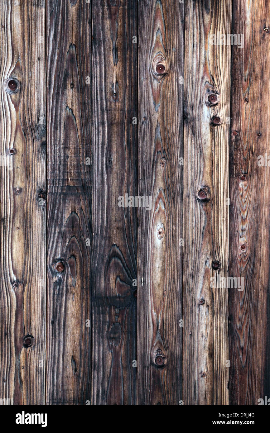 Weathered natural wooden wall close-up - Stock Image