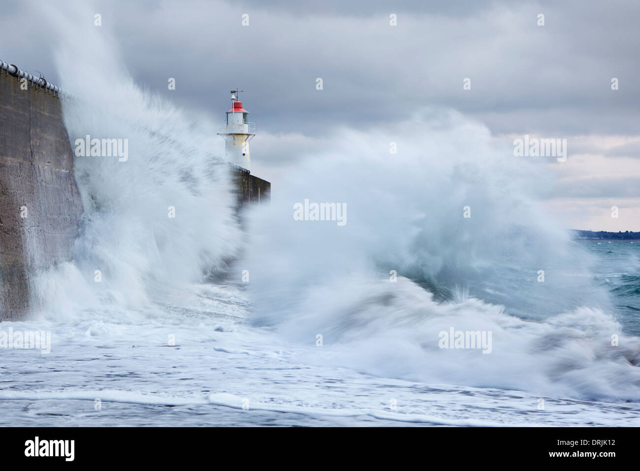 Large waves colliding into the sea wall at Newlyn Stock Photo