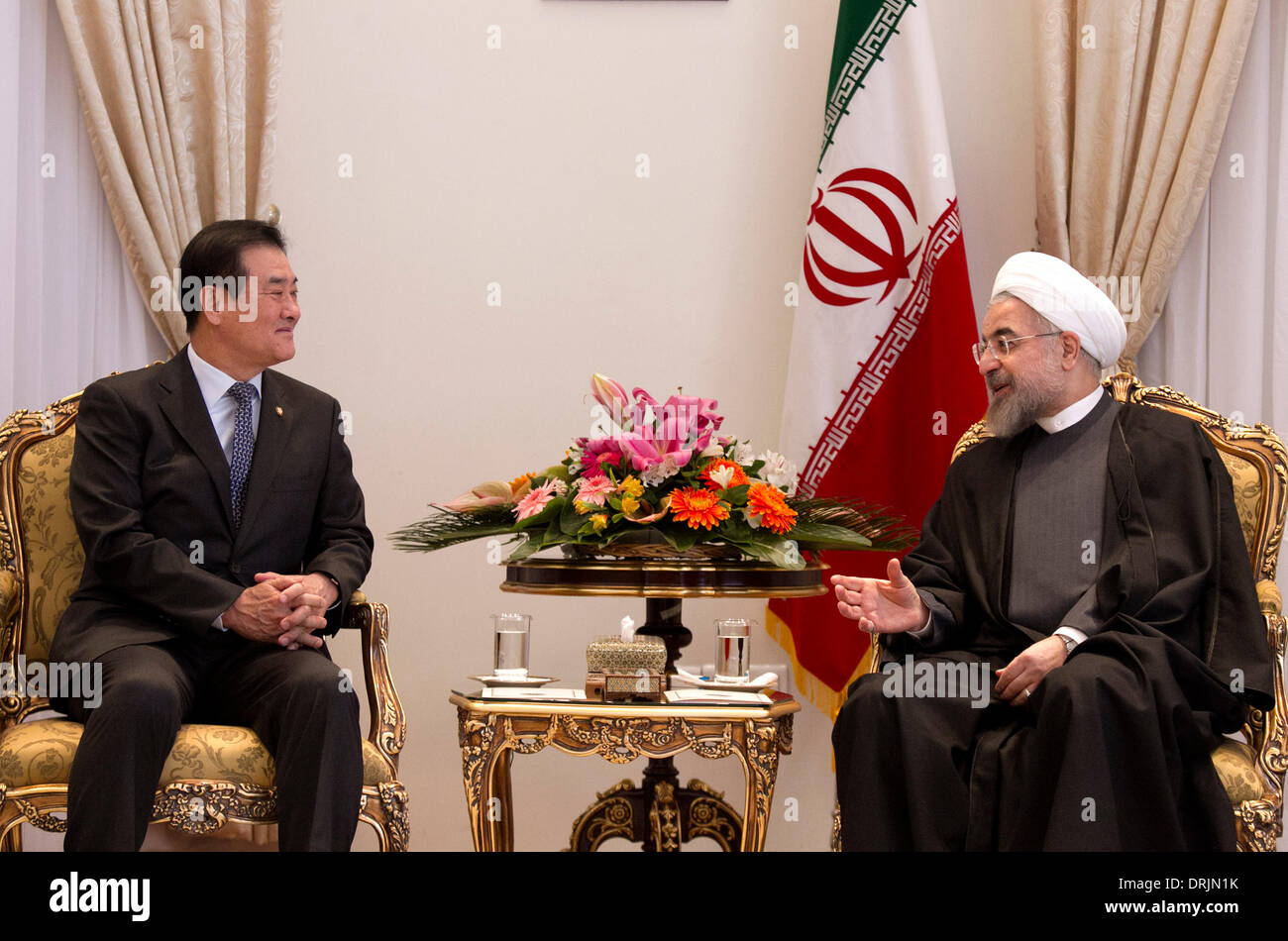 Tehran, Iran. 27th Jan, 2014. Iranian President Hassan Rouhani (R) talks with South Korean National Assembly Speaker Kang Chang-hee during their meeting at presidential palace in Tehran, capital of Iran, on Jan. 27, 2014. Rouhani called for closer economic ties with South Korea here on Monday, semi-official Fars news agency reported. Credit:  Ahmad Halabisaz/Xinhua/Alamy Live News - Stock Image
