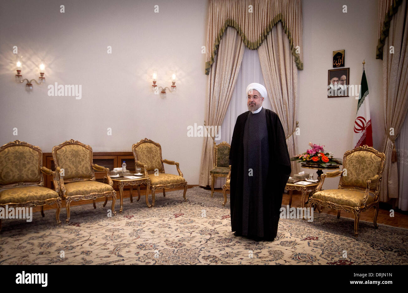 Tehran, Iran. 27th Jan, 2014. Iranian President Hassan Rouhani waits before his meeting with South Korean National Assembly Speaker Kang Chang-hee at presidential palace in Tehran, capital of Iran, on Jan. 27, 2014. Rouhani called for closer economic ties with South Korea here on Monday, semi-official Fars news agency reported. Credit:  Ahmad Halabisaz/Xinhua/Alamy Live News - Stock Image