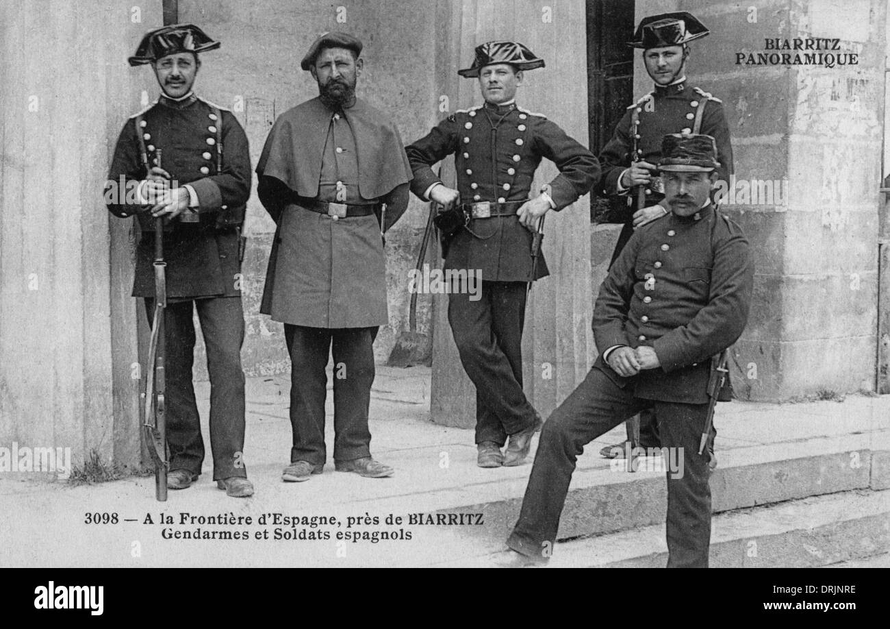 Spanish soldiers and gendarmes pose for a photograph. - Stock Image