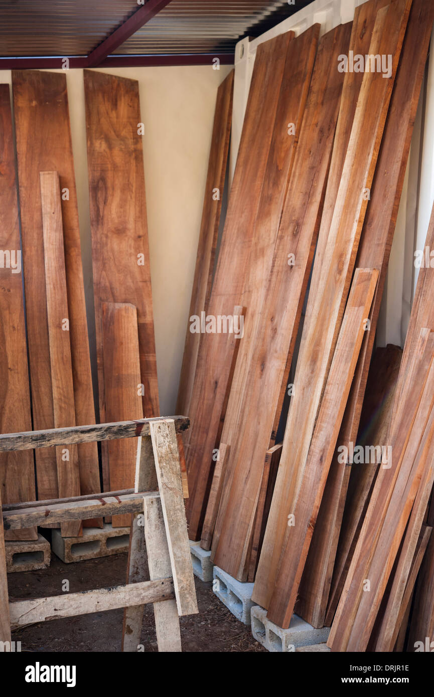 Rosewood planks drying in a carpenter's workshop - Stock Image