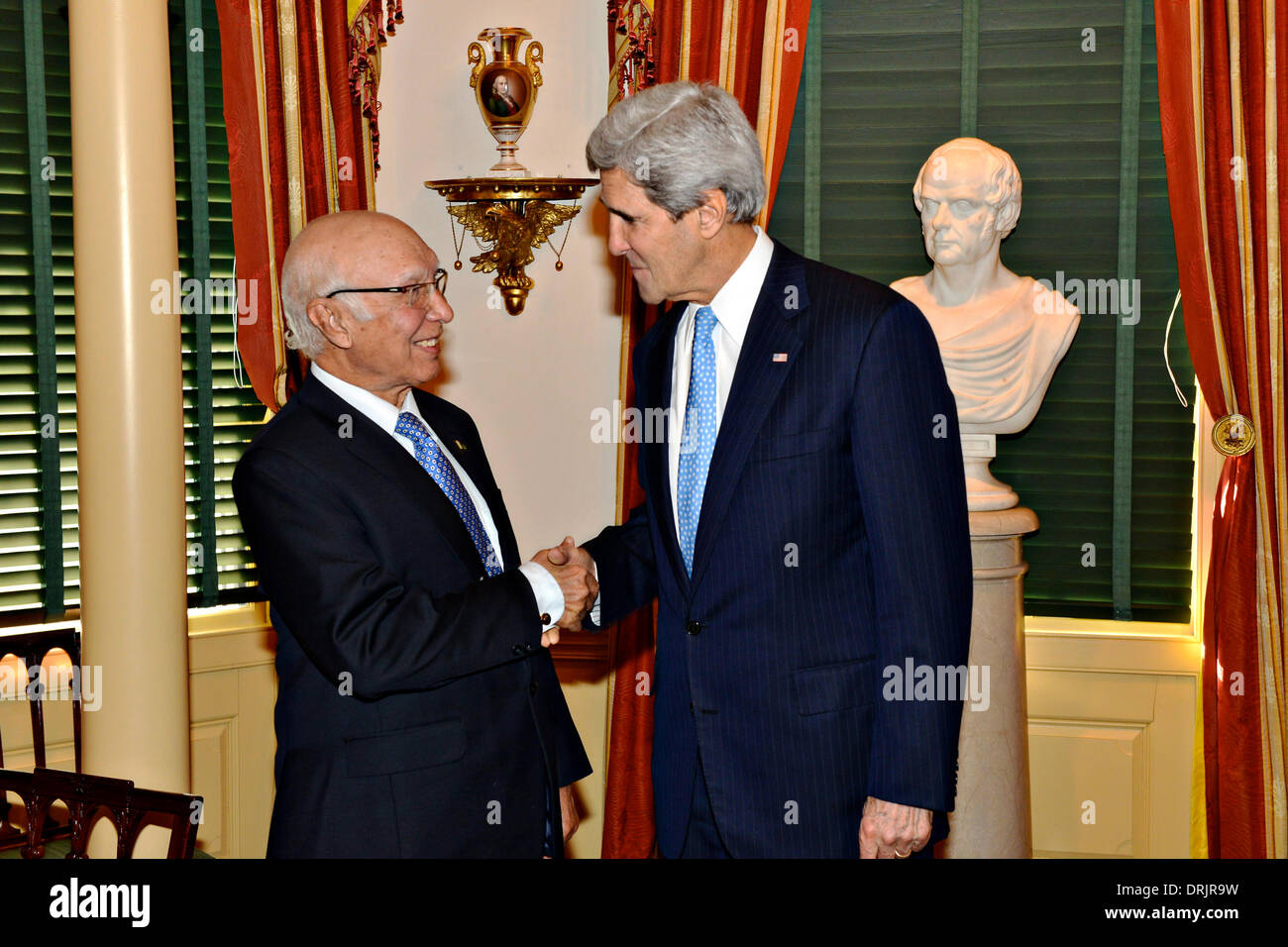 US Secretary of State John Kerry welcomes Pakistani National Security and Foreign Affairs Advisor Sartaj Aziz to the Department of State for the U.S.-Pakistan Strategic Dialogue Plenary Session January 27, 2014 in Washington, D.C. - Stock Image