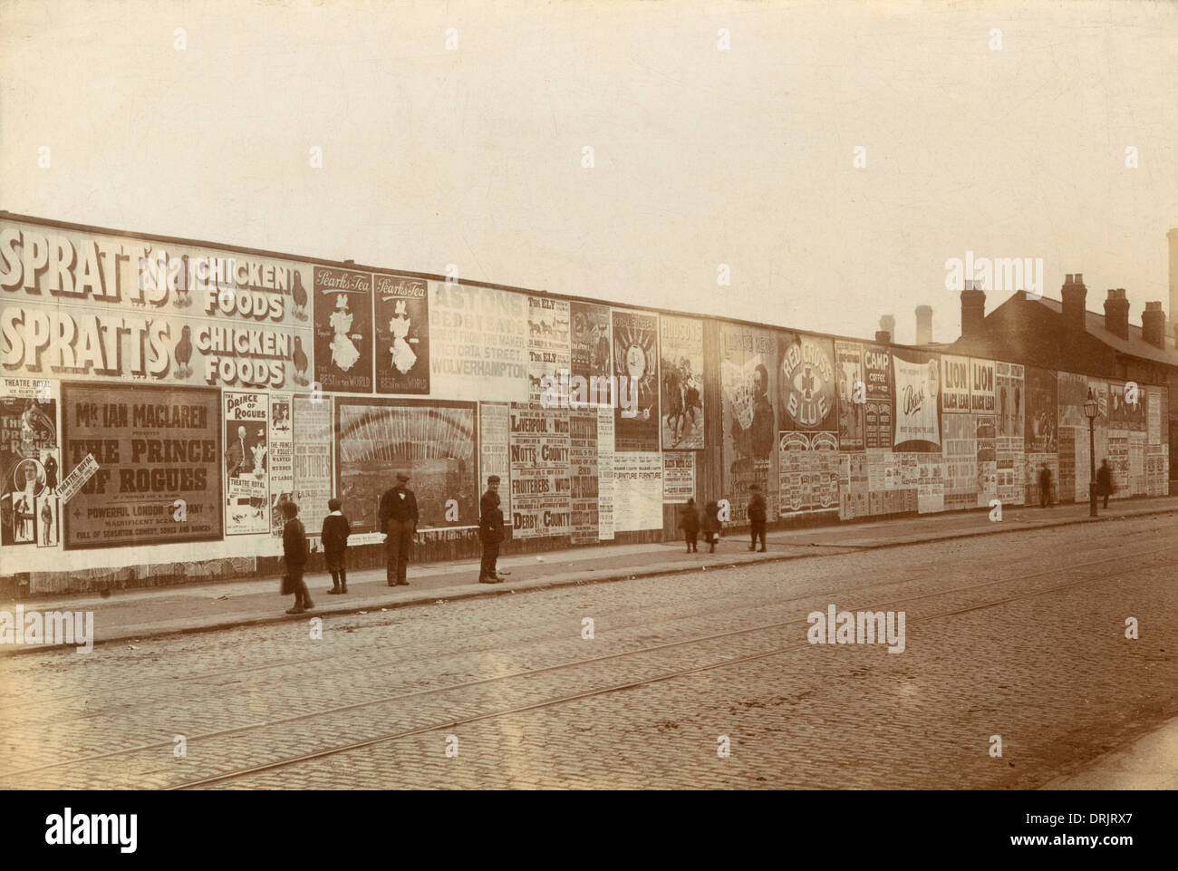 A wall of street poster advertisements in Wolverhampton. - Stock Image