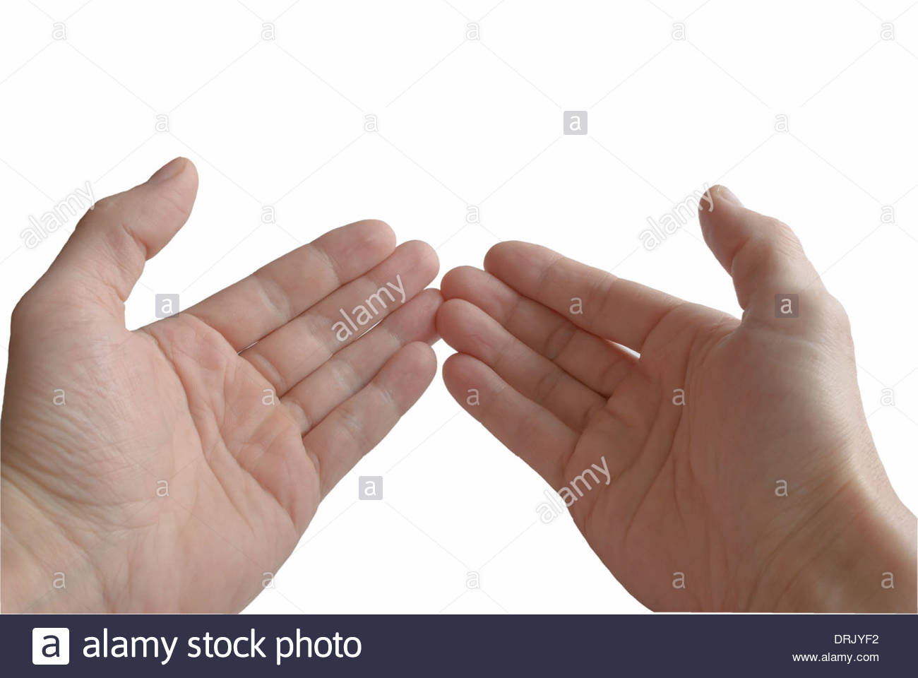 Two palms, close-up, in gesture of the prayer, on white background, isolated. - Stock Image