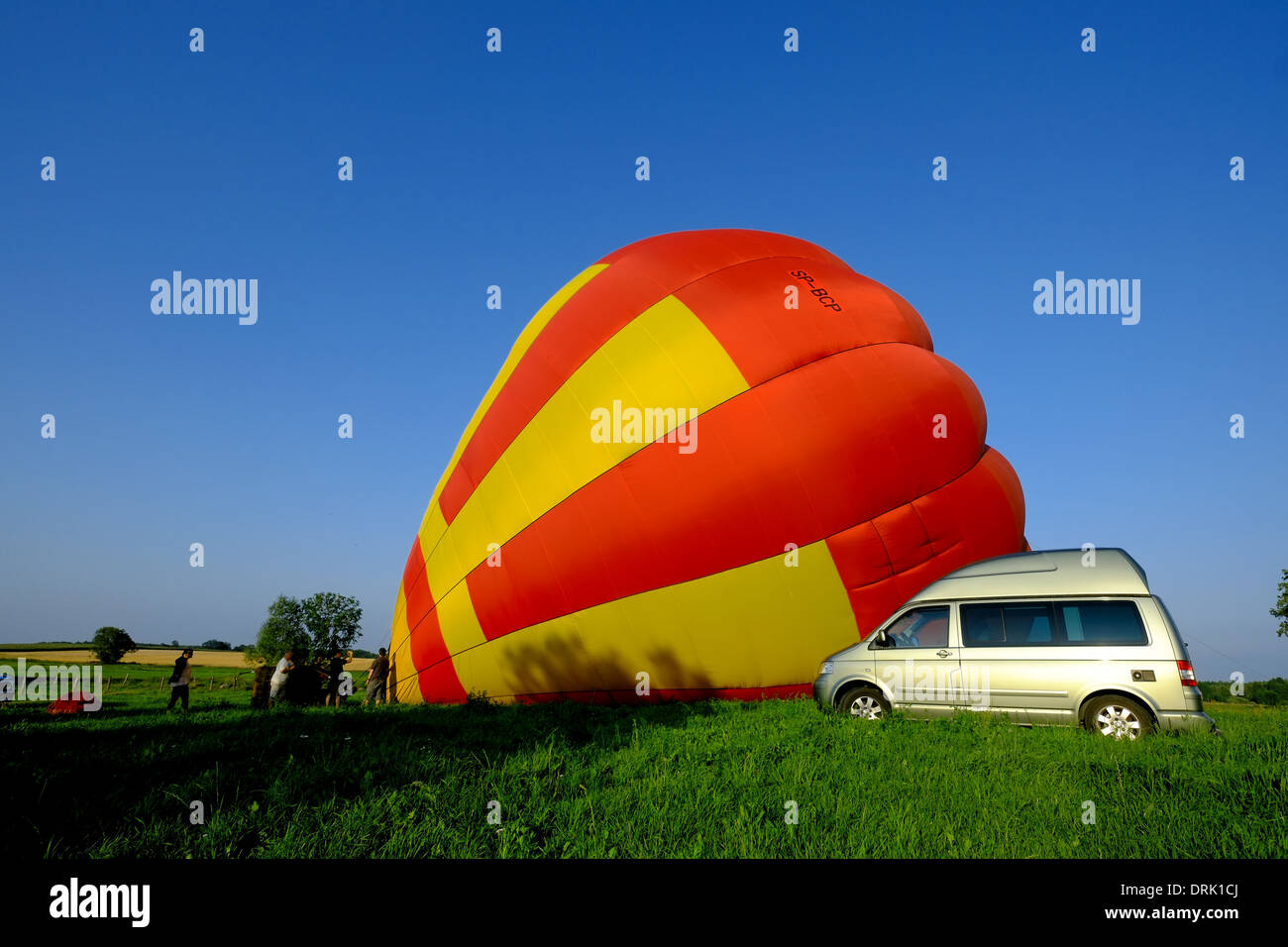 VW Volkswagen California Camper with Polyroof type roof next to a hot air Balloon - Stock Image