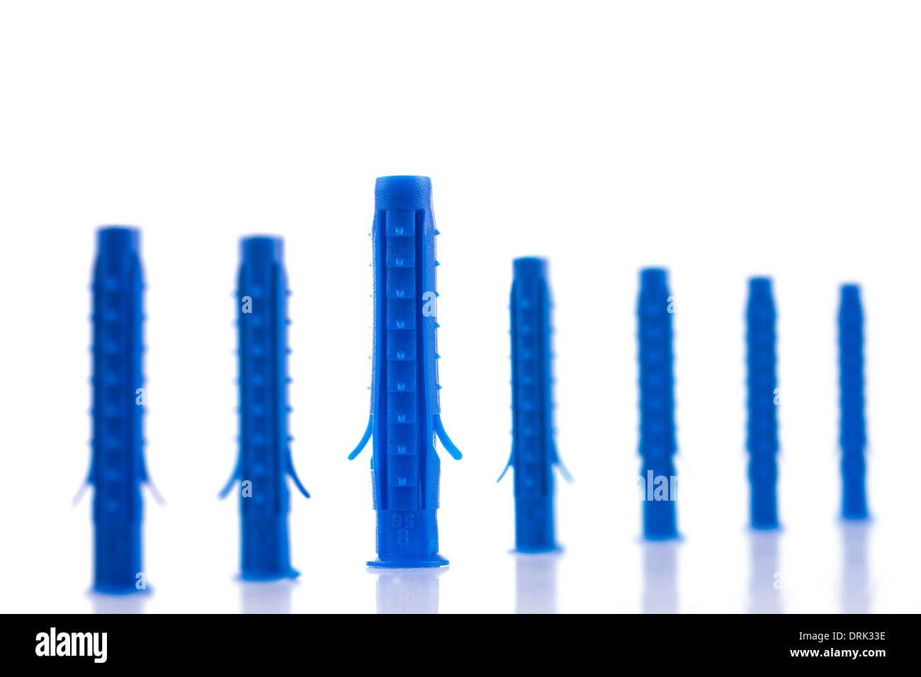 Group of plastic dowels on white background - Stock Image