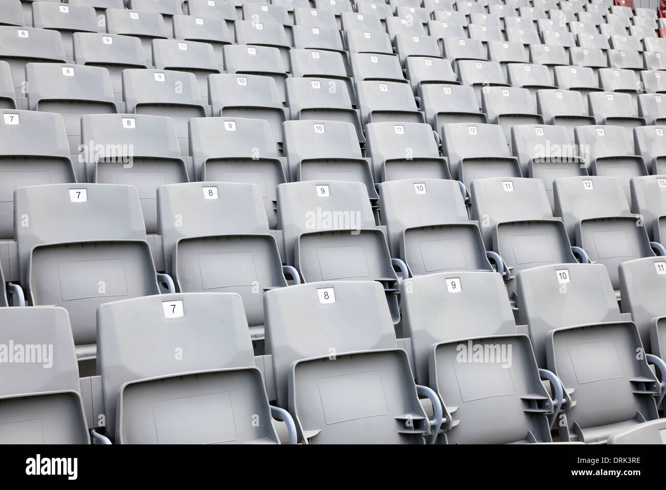 Empty seats in a sports stadium - Stock Image