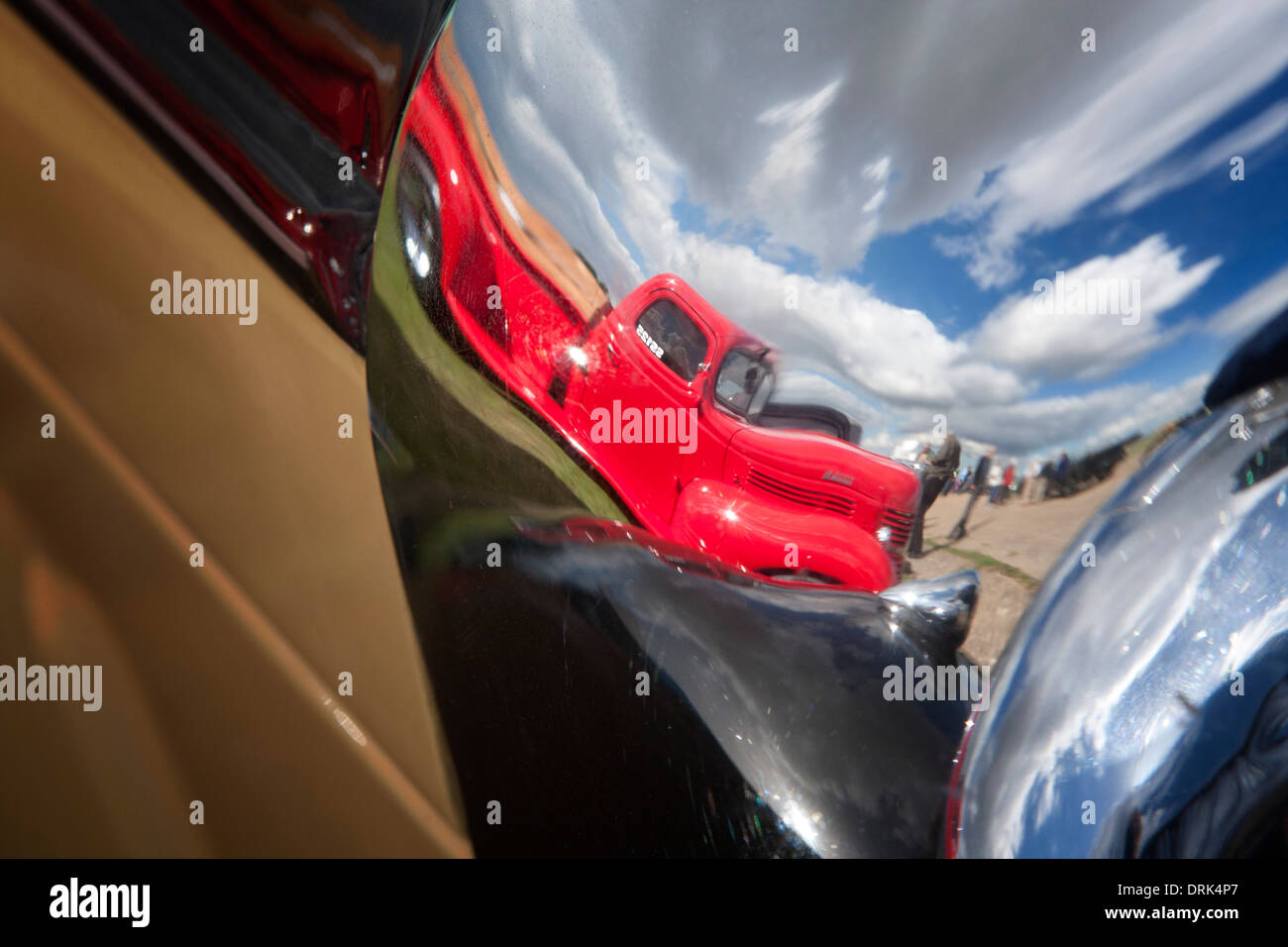 Reflection of pick up truck in chrome headlamp - Stock Image