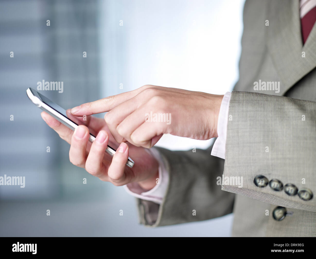 hand touching the screen of a smartphone. - Stock Image