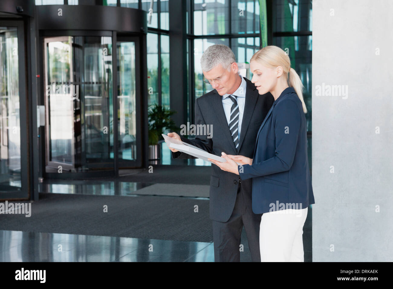 Germany, Business people discussing documents - Stock Image