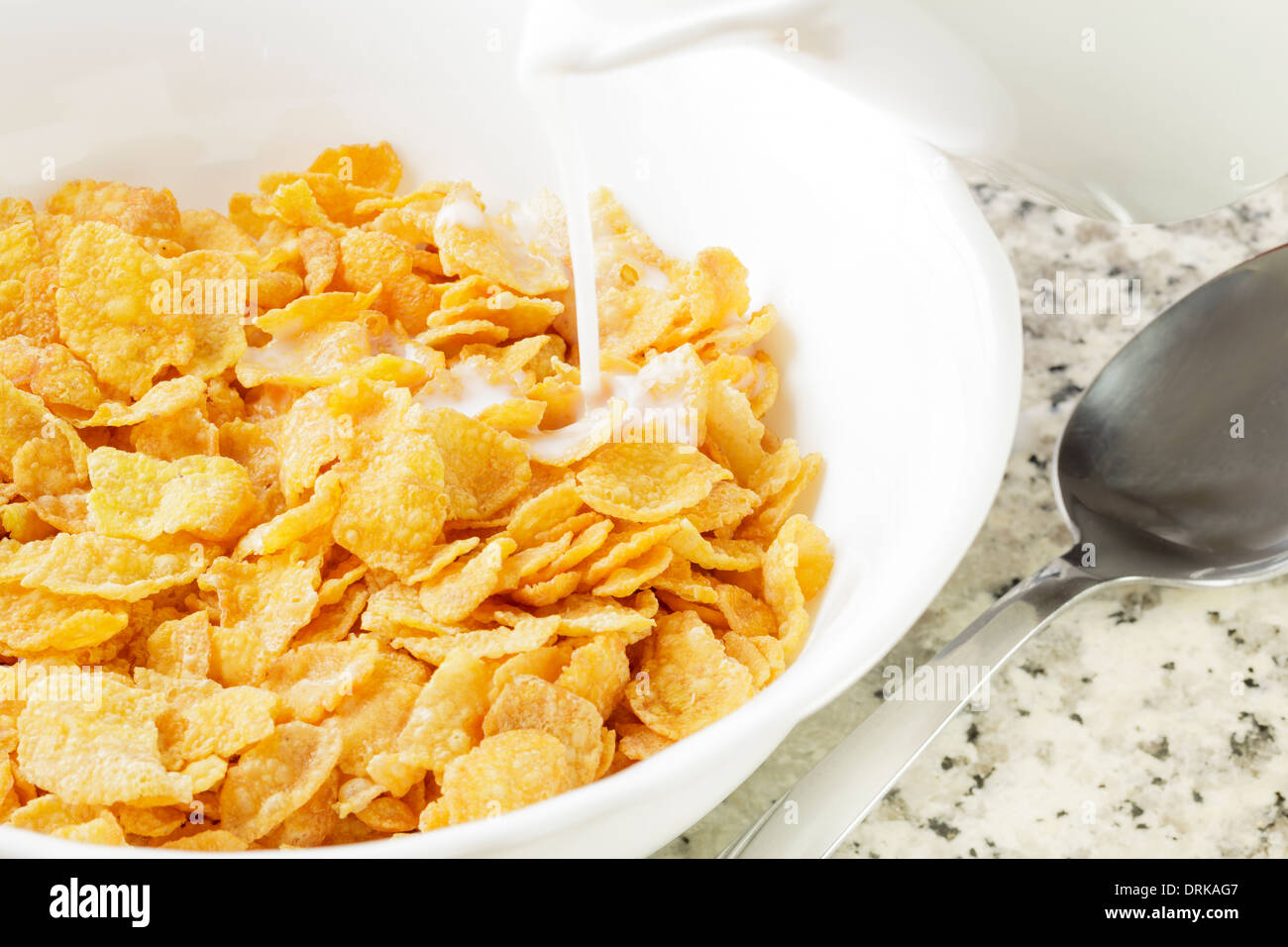 Cornflakes with milk being poured Stock Photo