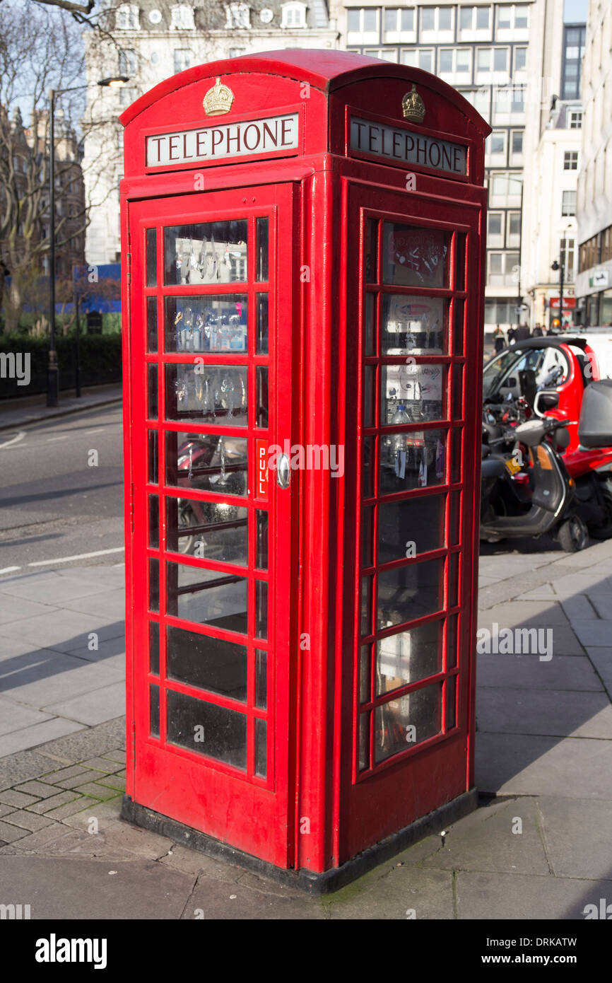 Traditional red telephone box in London. Old-fashioned. - Stock Image